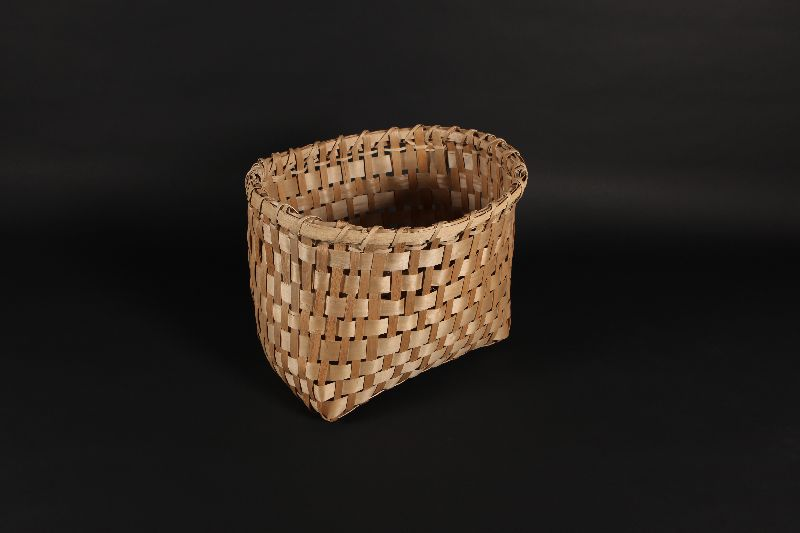 A medium size basket woven from ash bark.