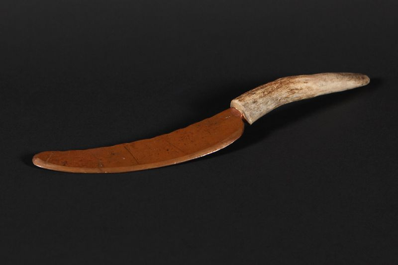 Replica of a knife with a copper blade and a handle made from caribou antler.
