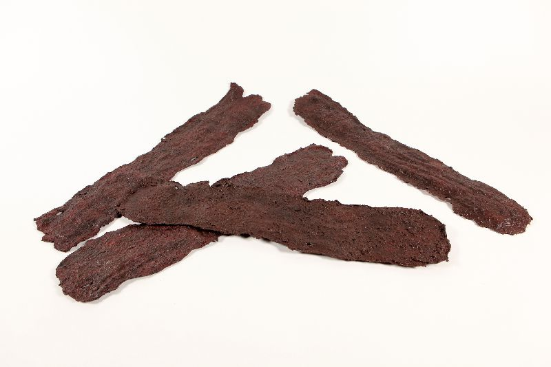 Replicas of four strips of beef jerky.