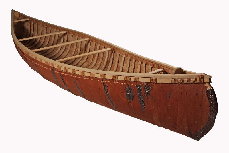 A birch bark canoe with a wooden frame. Traces of fir resin are visible.